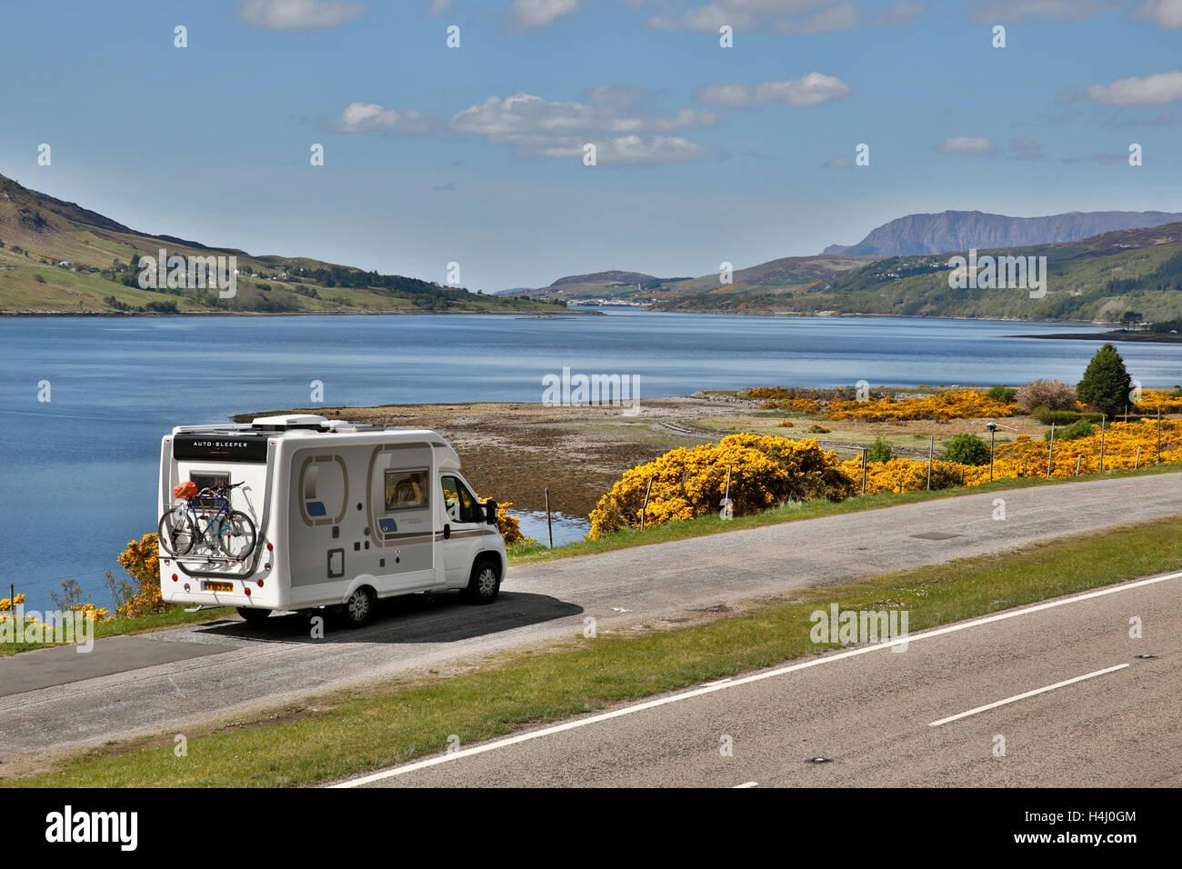 Loch Broom; Lookig Towards Ullapool; Motorhome Parked; Gorse in Flower; Scotland; UK - Stock Image