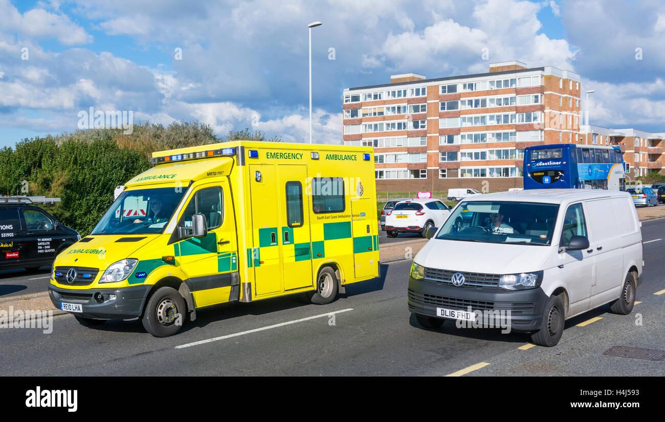 UK NHS ambulance on a call overtaking traffic to reach an emergency. Ambulance UK ambulance on call. - Stock Image
