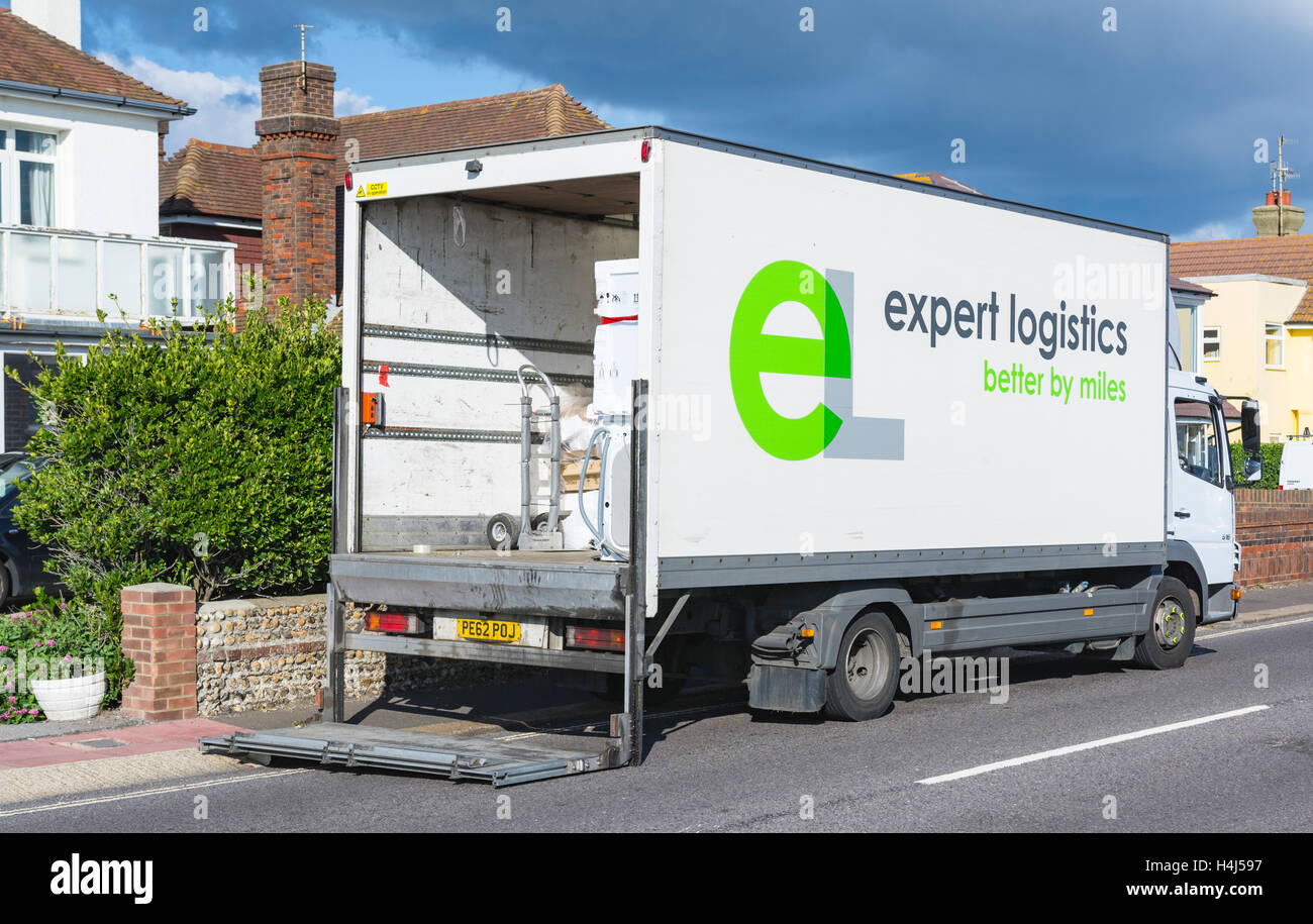 Expert Logistics delivery vehicle with the rear door open. - Stock Image