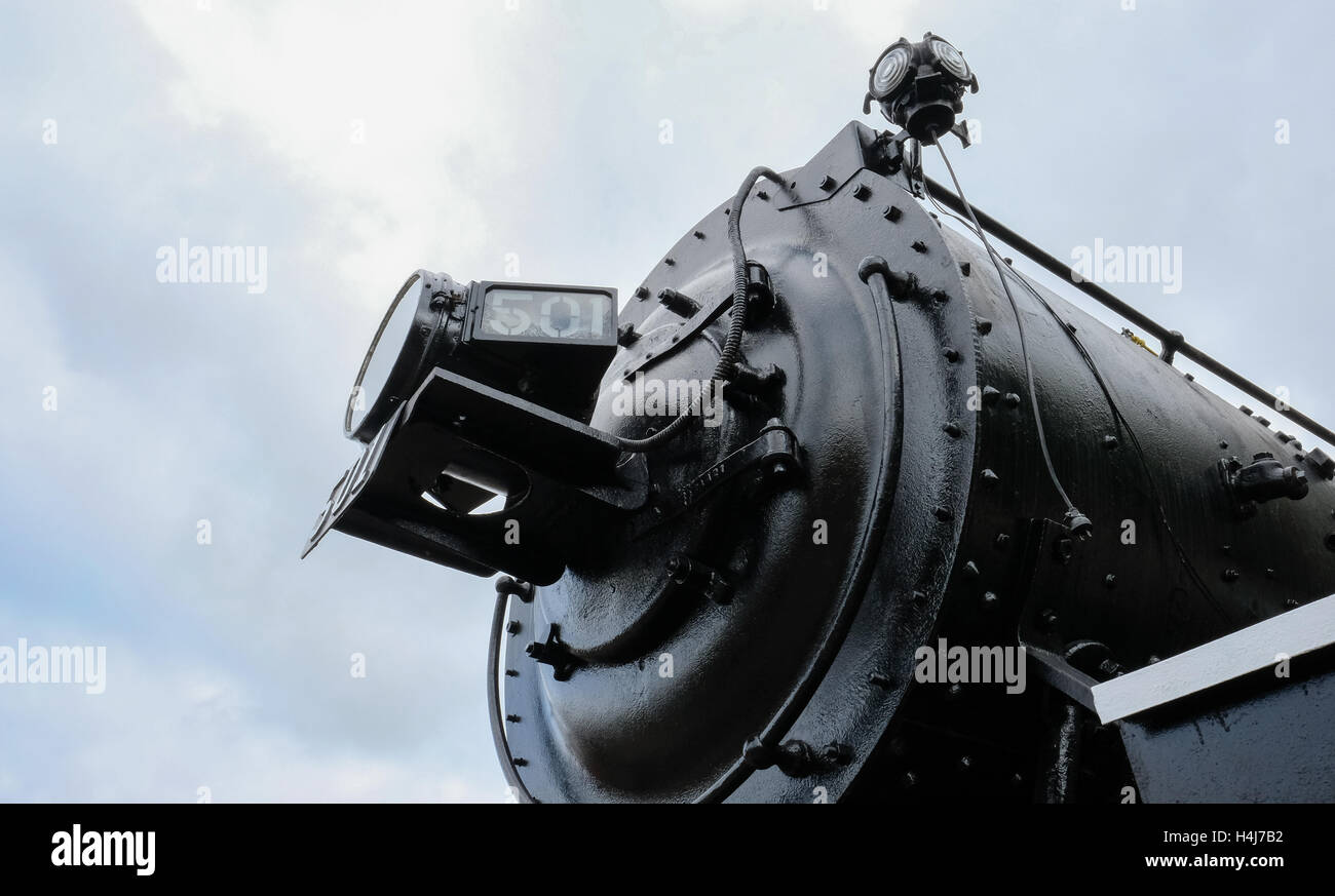Front view of an old steam locomotive train, showing its large central headlight and the 501 number plate. - Stock Image