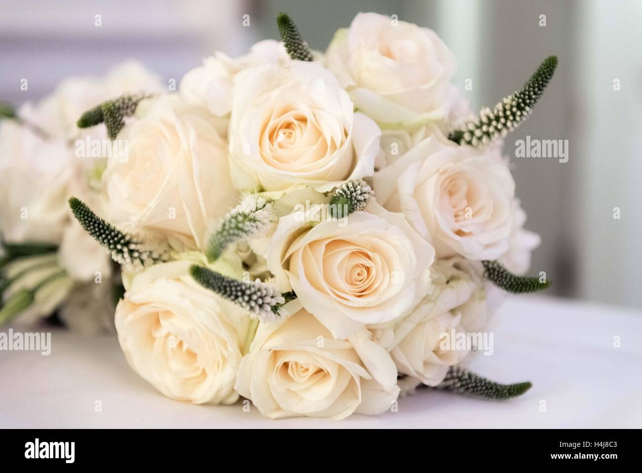 Wedding flower bouquet of white roses - Stock Image
