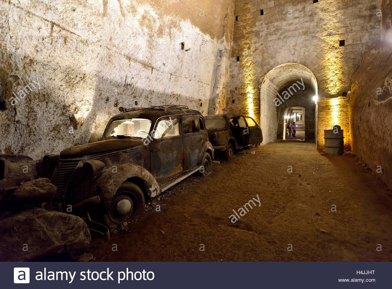 Abandoned tunnel with retro cars