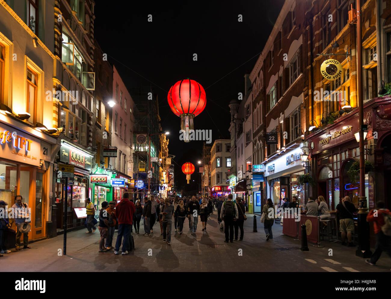 Pedestrians on Wardour Street, Nocturnal street scene, Chinatown, Soho, London, England, United Kingdom - Stock Image