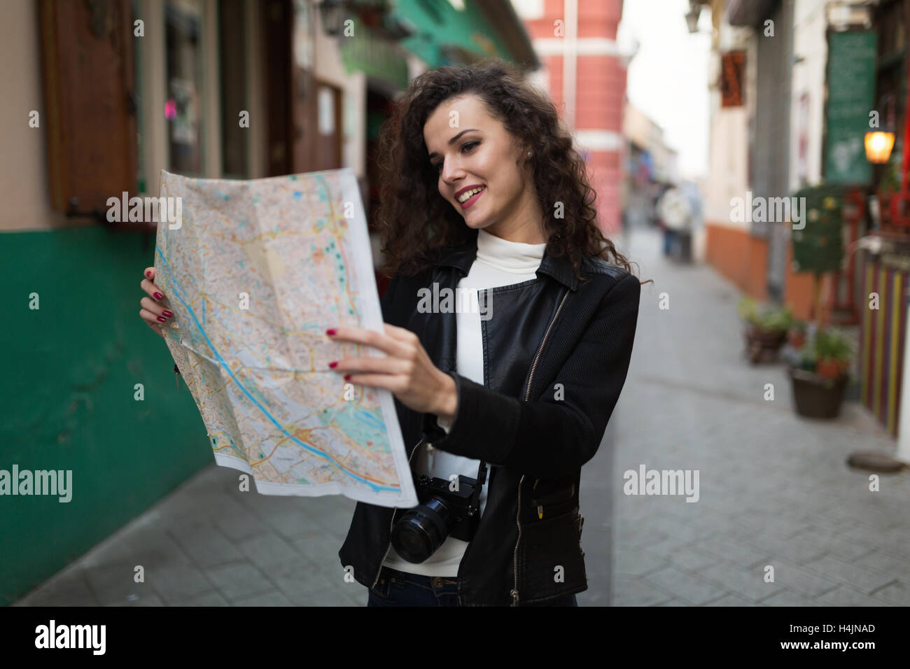 Beautiful lady exploring city and traveling - Stock Image
