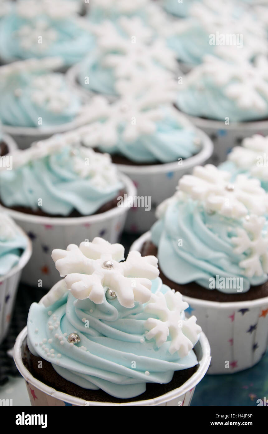 cup cakes with snowflakes decorating in the color of light blue for a celebrating birthday party Stock Photo
