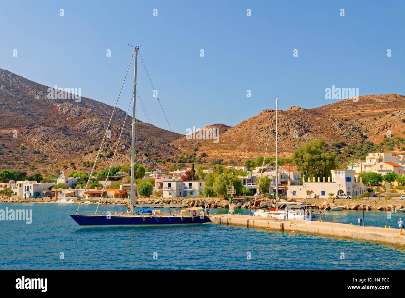 Tilos town quay on the Greek island of Tilos situated between Rhodes and Kos in the Dodecanese Island group, Greece. - Stock Image