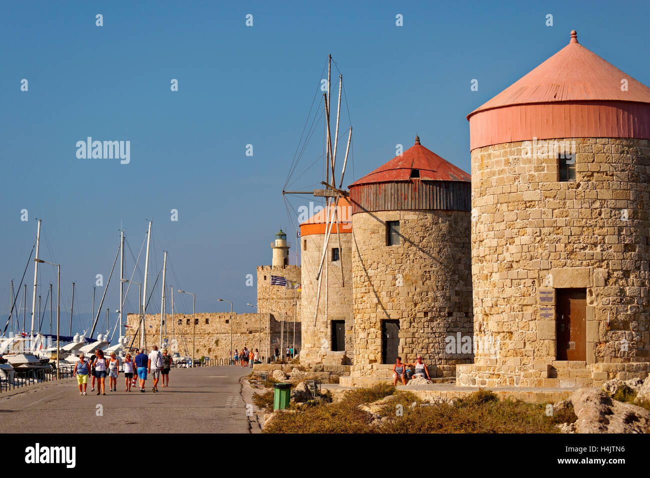 Old windmills at Rhodes city harbour, Island of Rhodes, Dodecanese island group, Greece. - Stock Image