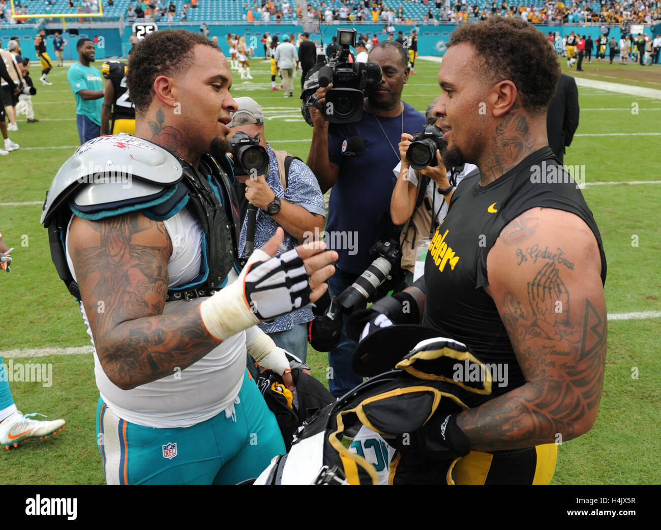 Miami gardens fl usa 16th oct 2016 miami dolphins center mike miami dolphins center mike pouncey 51 and twin brother pittsburgh steelers center maurkice pouncey 53 meet after the game miami dolphins vs m4hsunfo