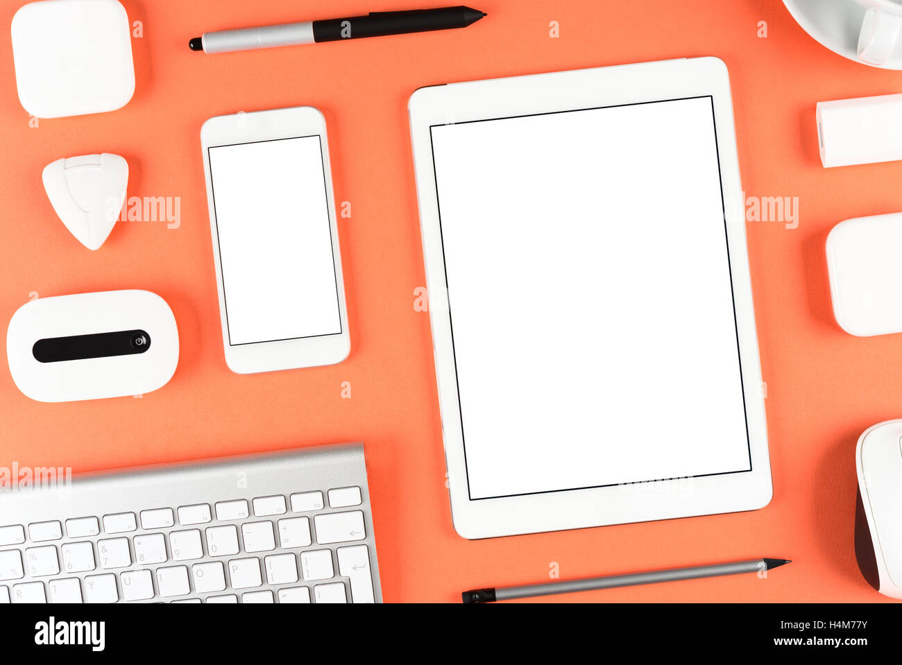 Responsive design: Keyboard, tablet and smartphone on red table Stock Photo