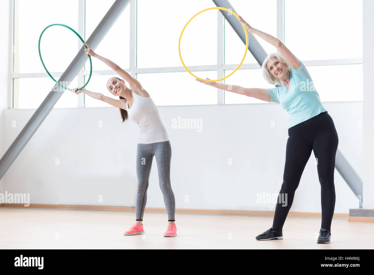 Active sporty women working out using sports equipment - Stock Image