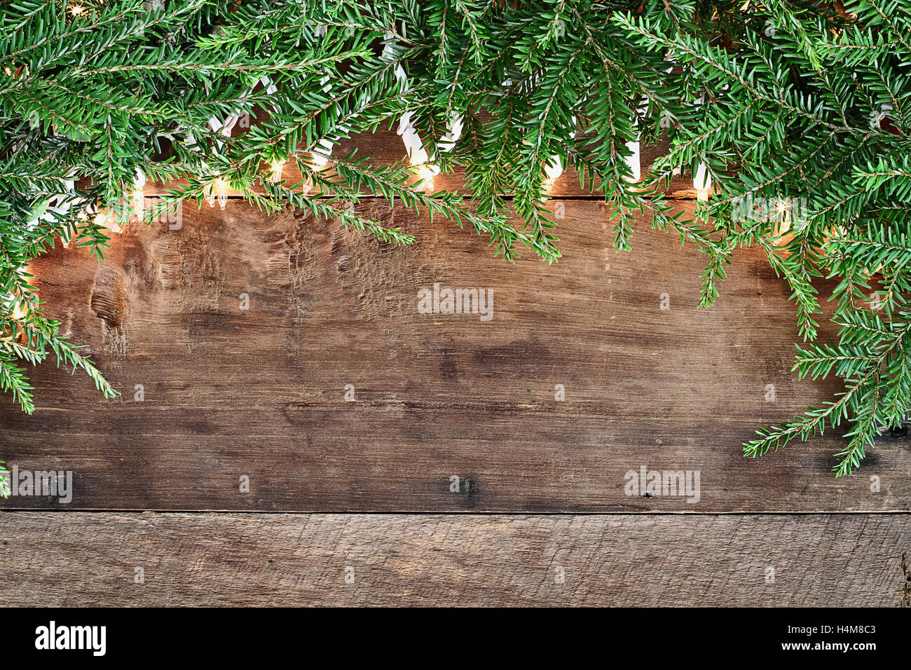 Christmas Tree Pine Branches And Decorative Lights Over A Rustic Background Of Barn Wood Image Shot From Overhead
