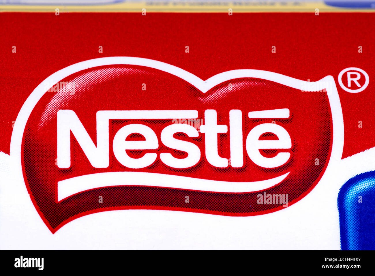 LONDON, UK - OCTOBER 13TH 2016: A close-up of the Nestle logo on one of their confectionery products. - Stock Image