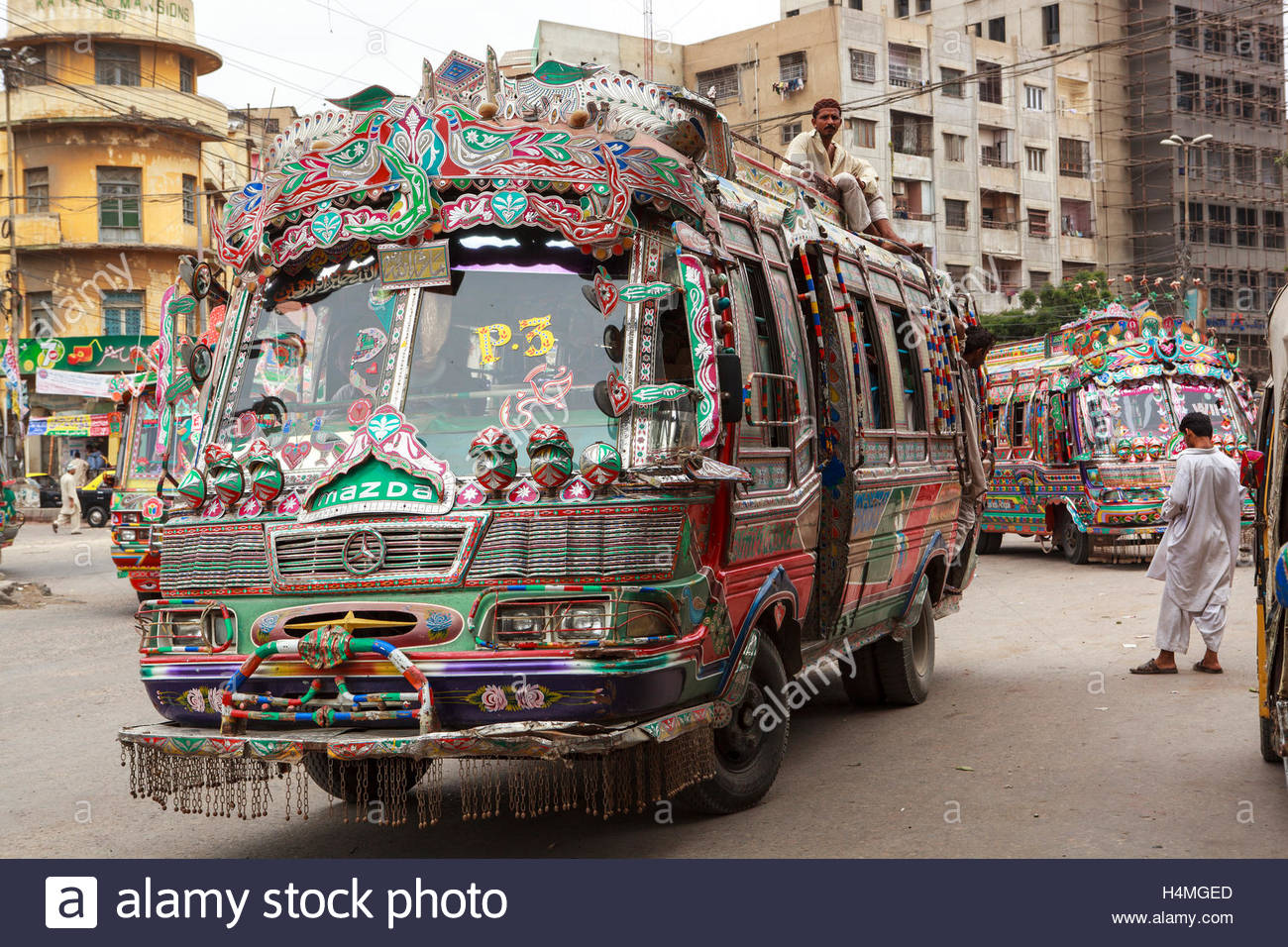 A colorfully adorned bus in the center of Karachi ...