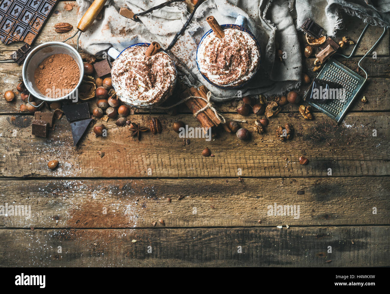Hot chocolate with whipped cream, nuts, spices and cocoa powder - Stock Image