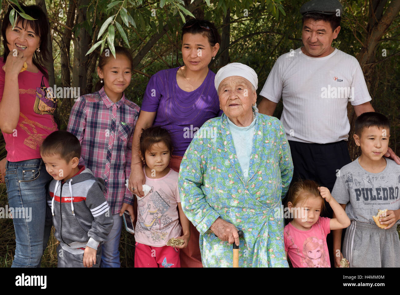 Extended Kazakh family at a rest stop from road trip to Altyn Emel National Park Kazakhstan - Stock Image