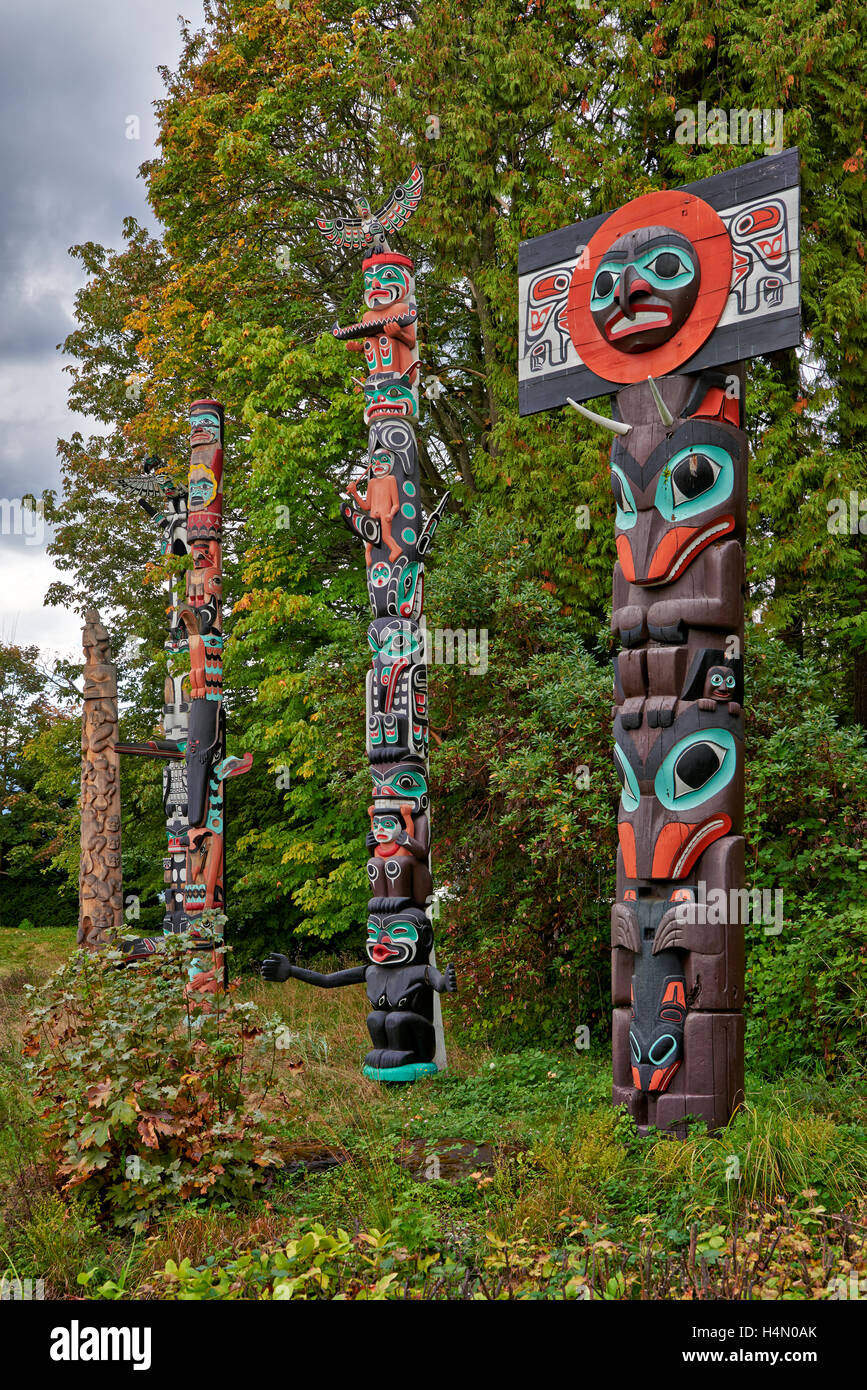 Totem poles in Stanley Park, Vancouver, British Columbia, Canada - Stock Image