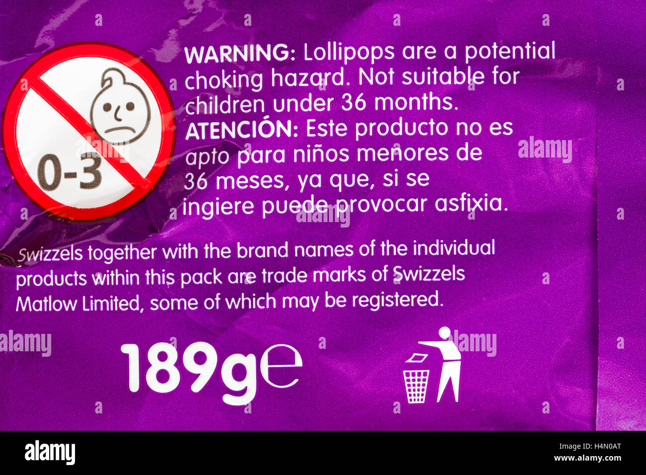 Warning lollipops are a potential choking hazard - information on pack of Swizzels loadsa chews - Stock Image