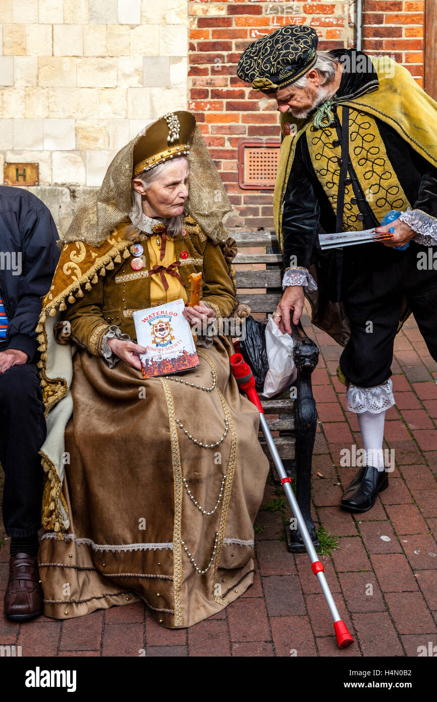 A Local Man and Woman Sell Programmes For The Upcoming Guy Fawkes Night Celebrations, Lewes, Sussex, UK - Stock Image