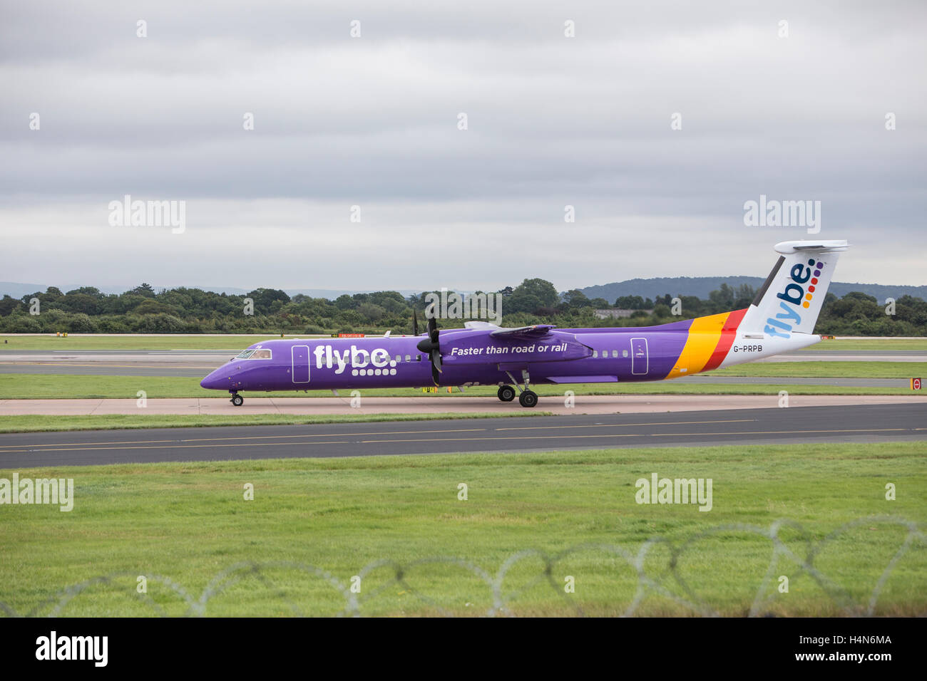 Bombadier Dash 8 Aircraft owned by Flybe Airlines at Manchester Ringways Airport - Stock Image