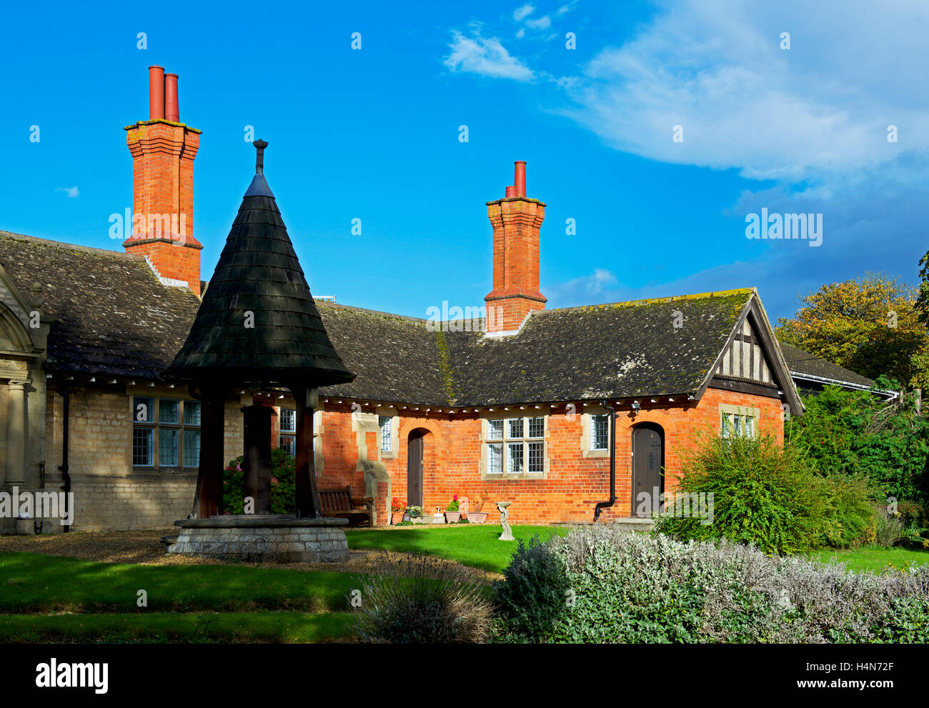 Almshouses in the village of Helpston, Cambridgeshire, England UK - Stock Image