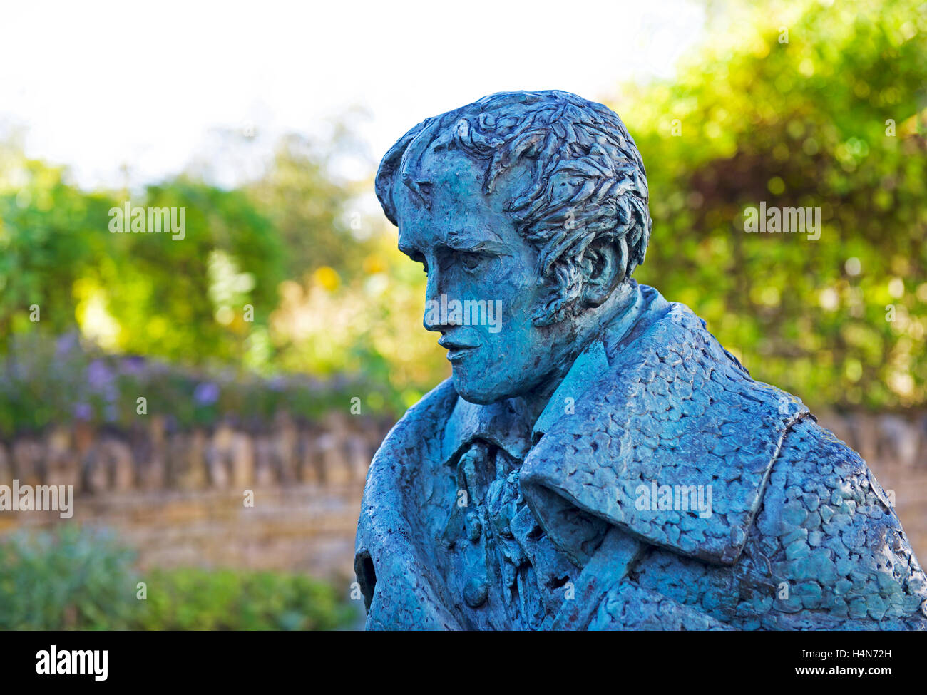 Sculpture of peasant poet John Clare, outside the cottage where he was born, in Helpston, Cambridgeshire, England - Stock Image