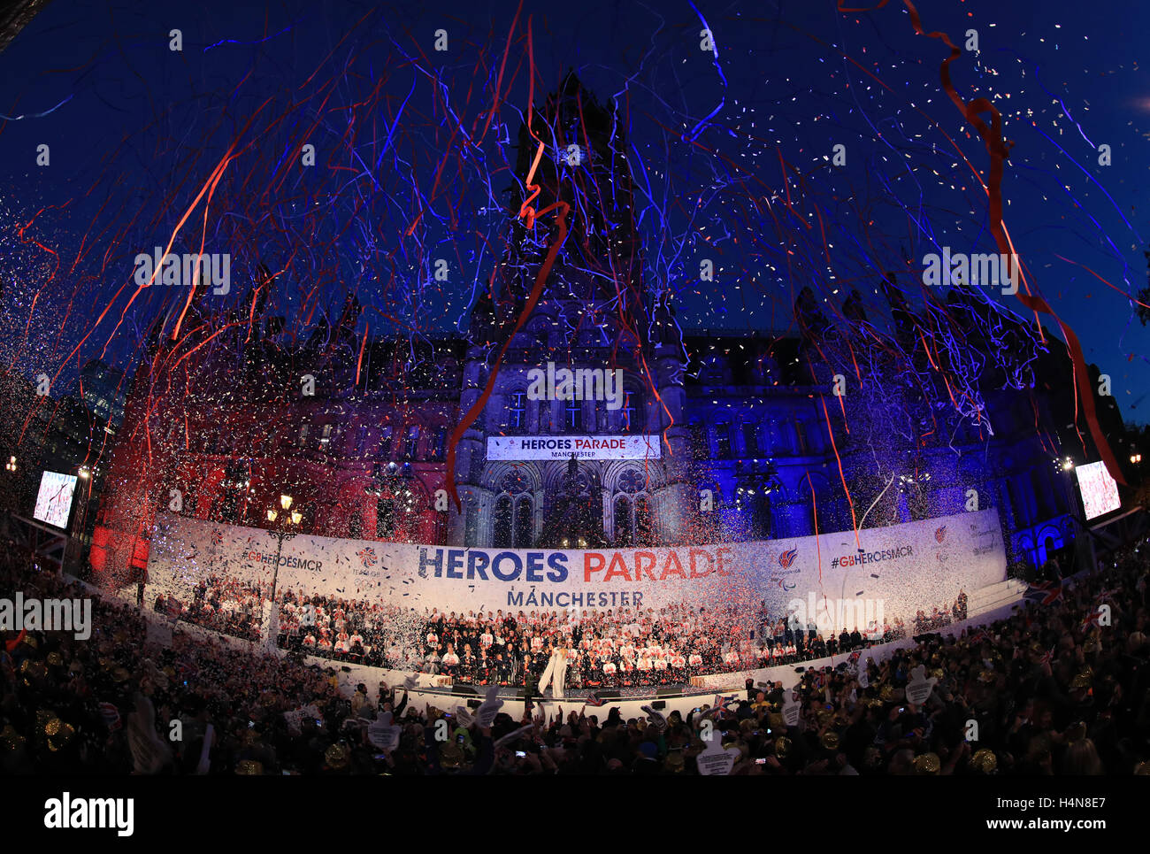 General view as glitter falls at the end of the Olympic and Paralympic athletes celebration parade in Manchester. Stock Photo