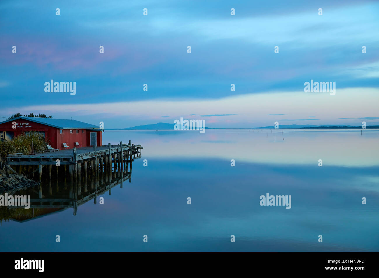 Jellicoe Sea Scout Building and reflections in New River Estuary at dusk, Invercargill, Southland, South Island, - Stock Image