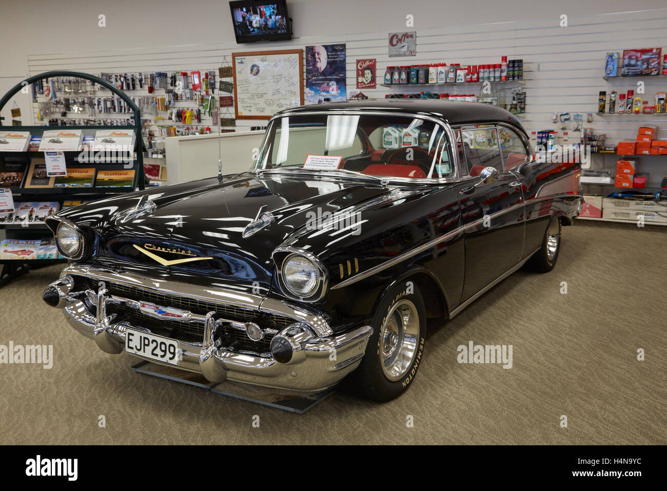 1957 Chevrolet two door hardtop displayed in E Hayes and Sons hardware shop, Invercargill, Southland, South Island, - Stock Image