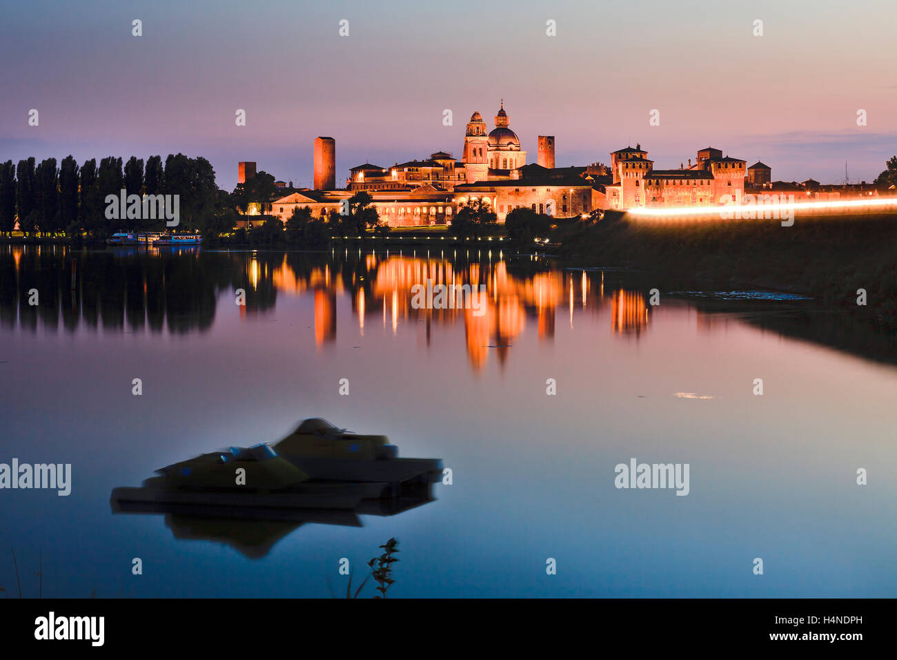 Bright Saint George castle - part of Duke's palace architectural ensemble in Mantua city of Italy at sunset - Stock Image
