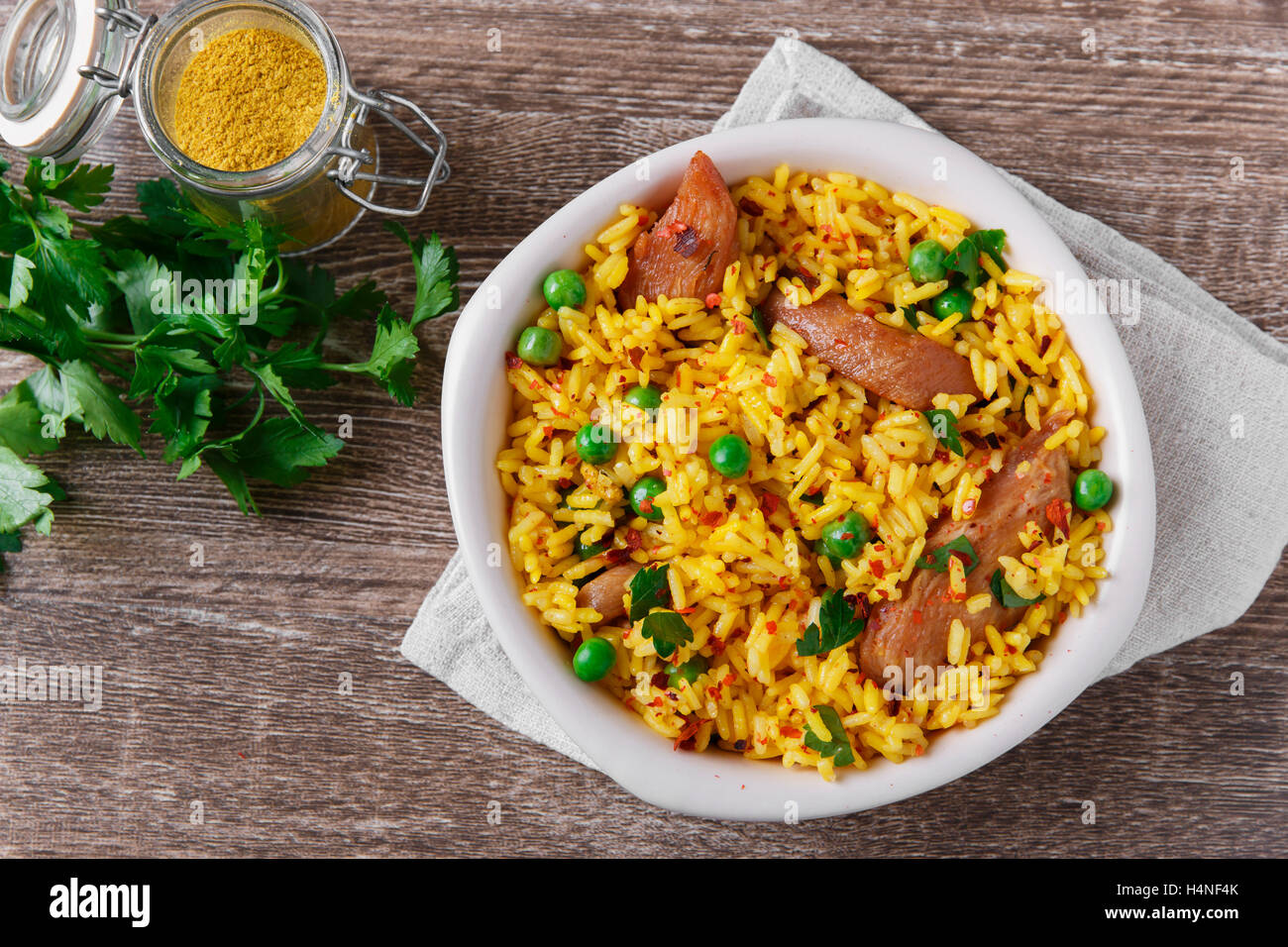 rice with meat curry green peas cooked - Stock Image
