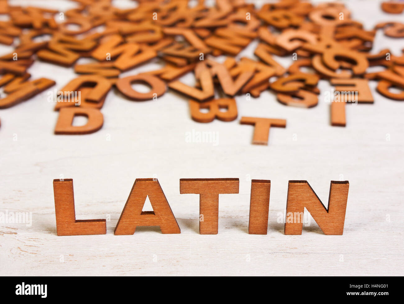 latin word from wooden letters on a white background old stock photo