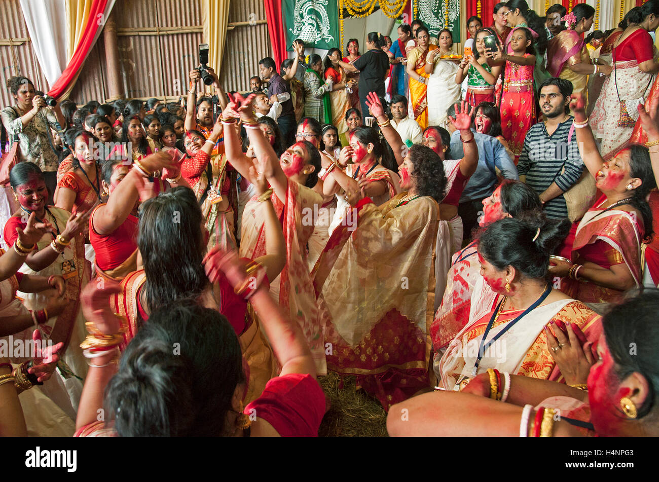 The image of Married Bengali women dance with drum beat at