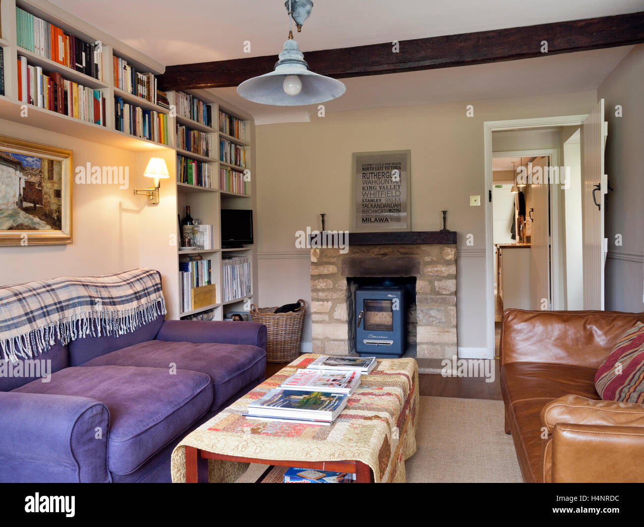 A Small Cottage Living Room With A Stylish Stove In The Fireplace Stock Photo Alamy