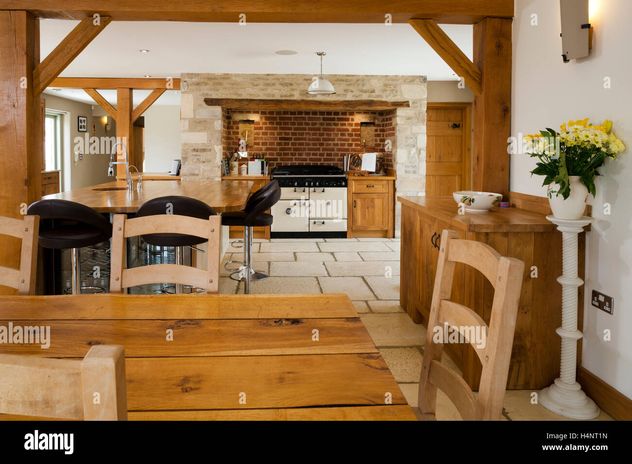 A luxury upmarket open plan barn conversion kitchen and dining area - Stock Image