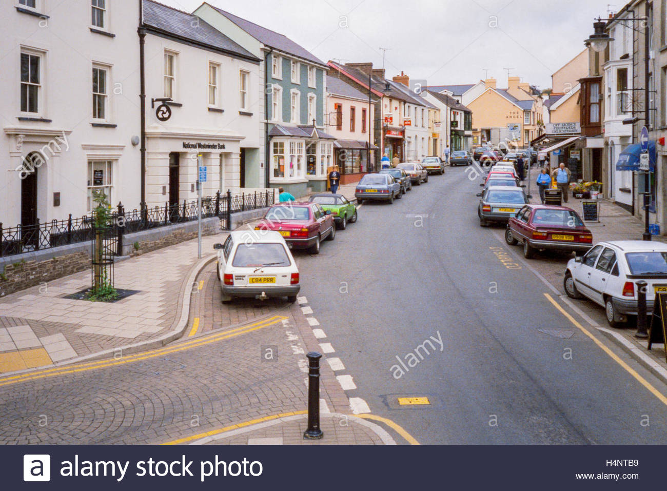 Narberth, Pembrokeshire, Wales, UK - street scene with parked cars, business premises and shops - 1995 - Stock Image