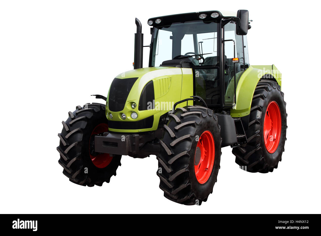Modern heavy tractor isolated on a white background. - Stock Image