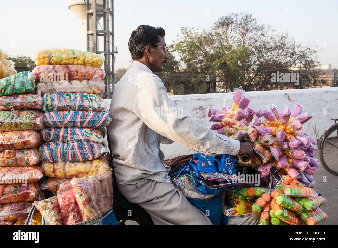 Bicycle loaded down with snacks in centre of Ahmedabad, Gujurat state,India,South,Asia. - Stock Image