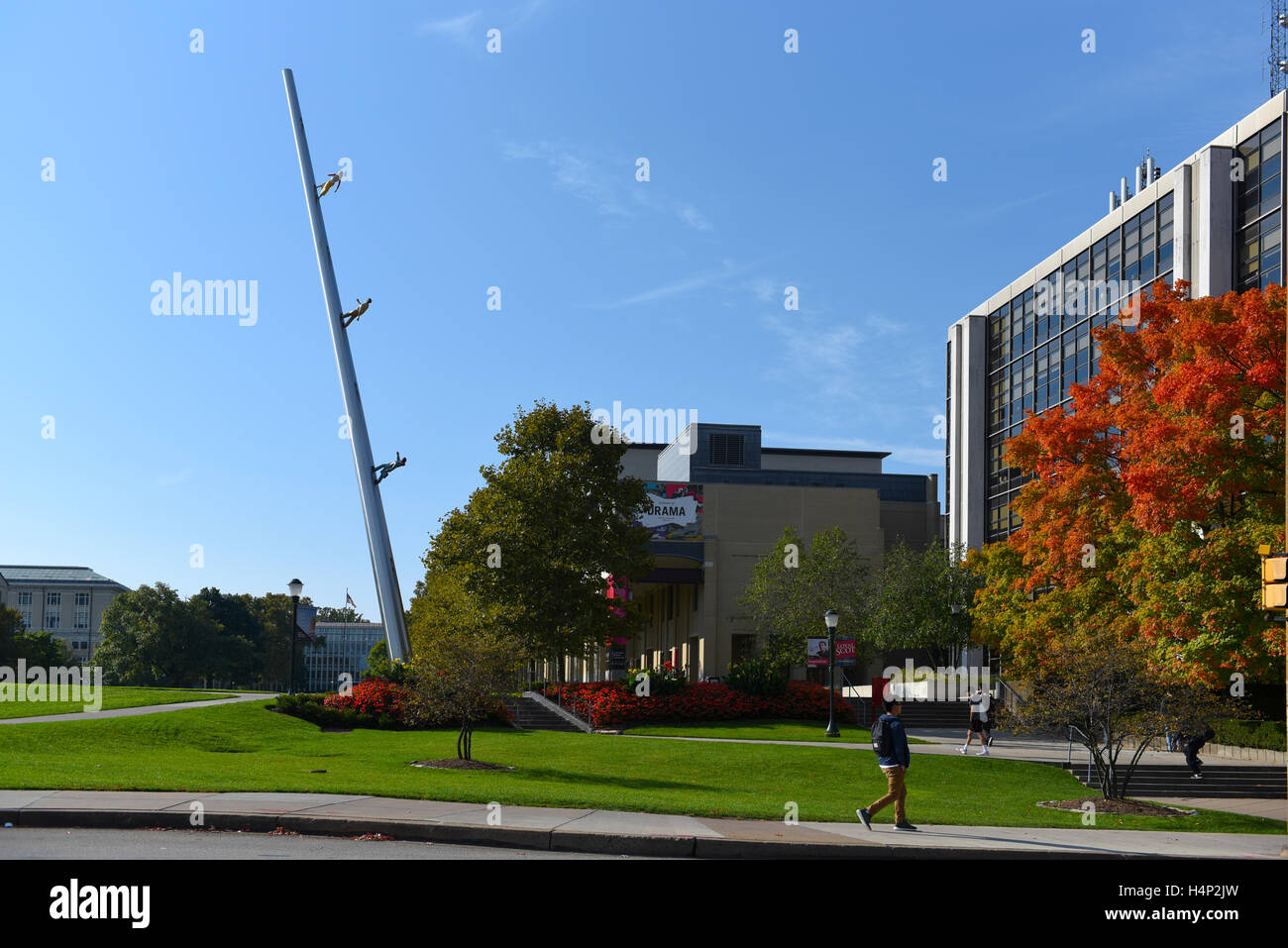 USA Pittsburgh PA Pennsylvania university campus of Carnegie Mellon fall with art piece 'Walking to the Sky' - Stock Image