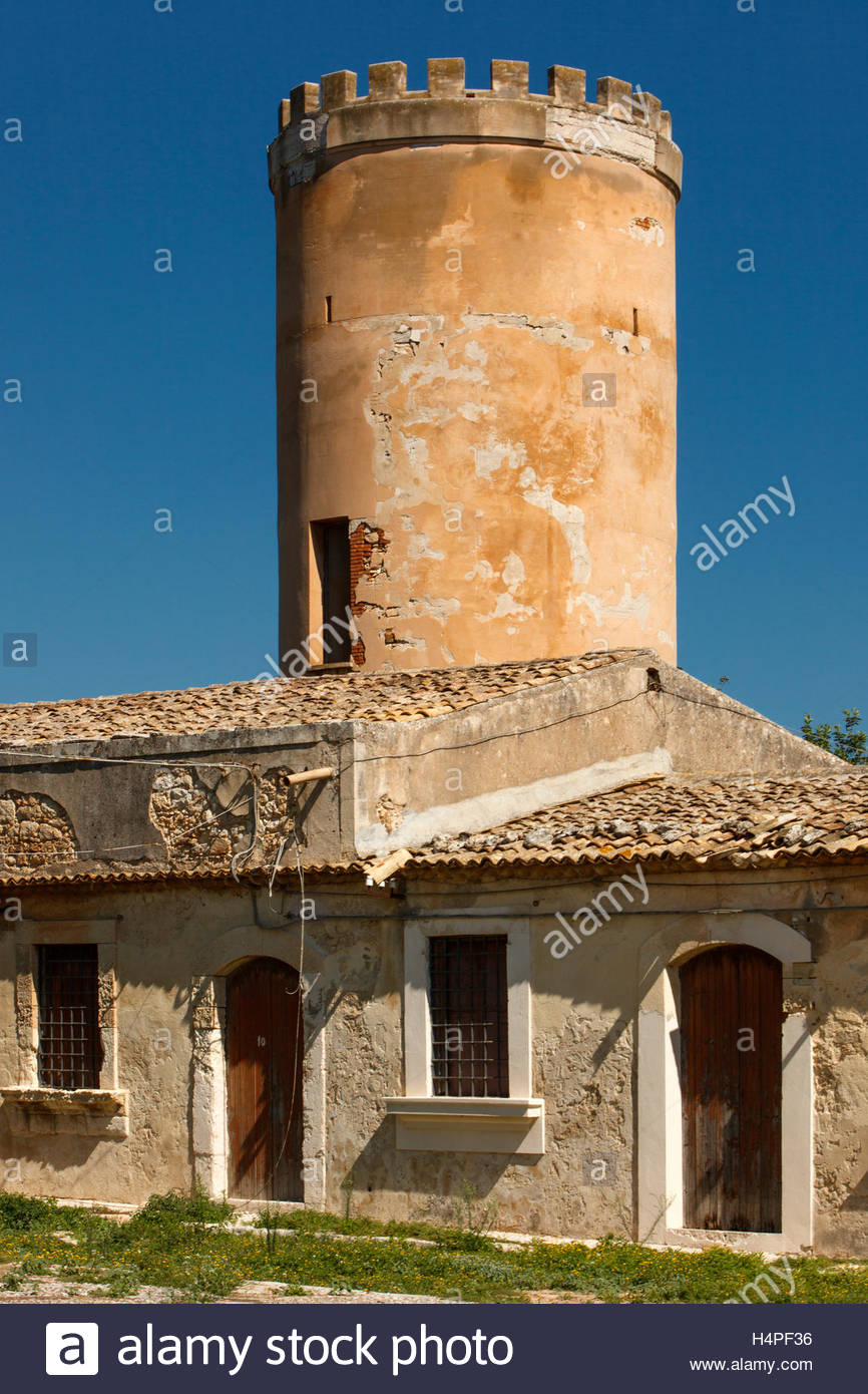 Centuries old stone and stucco buildings and tower on an inactive estate in rural Sicily, Italy. Stock Photo