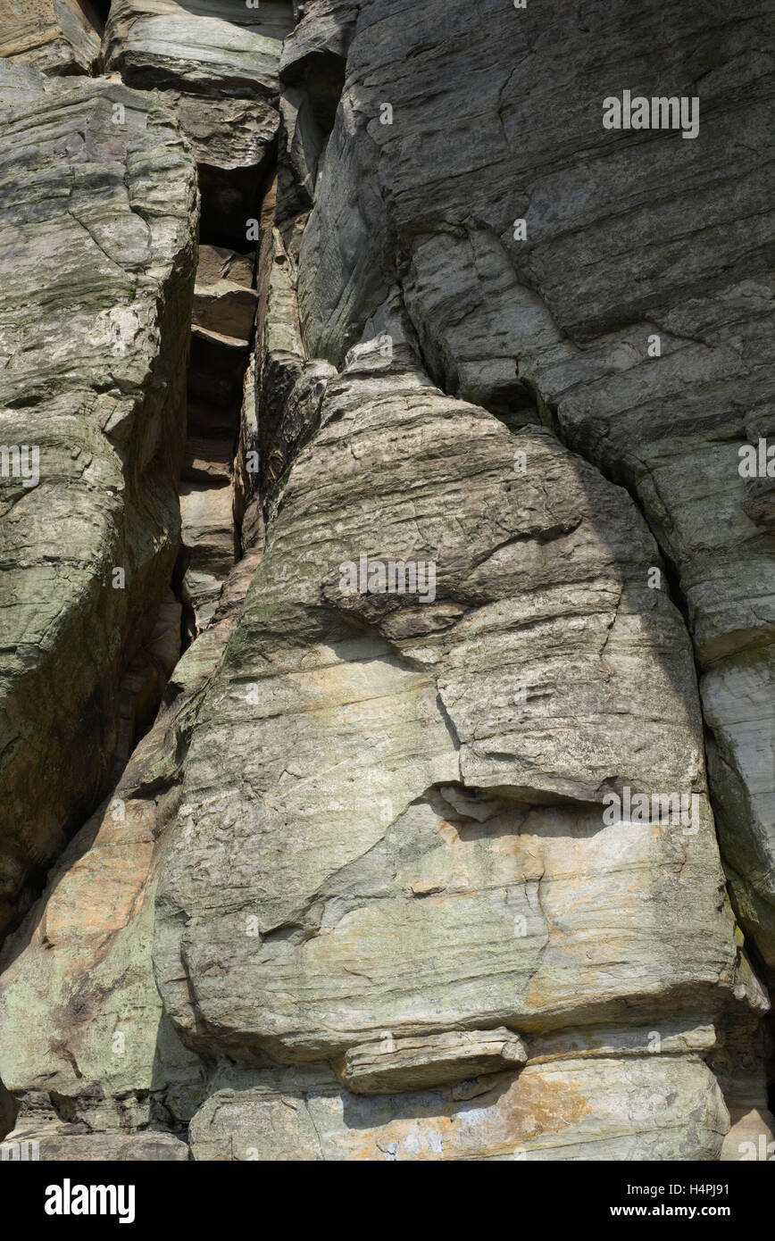hidden faces in the metamorphic quartzite rock on the big pinnacle