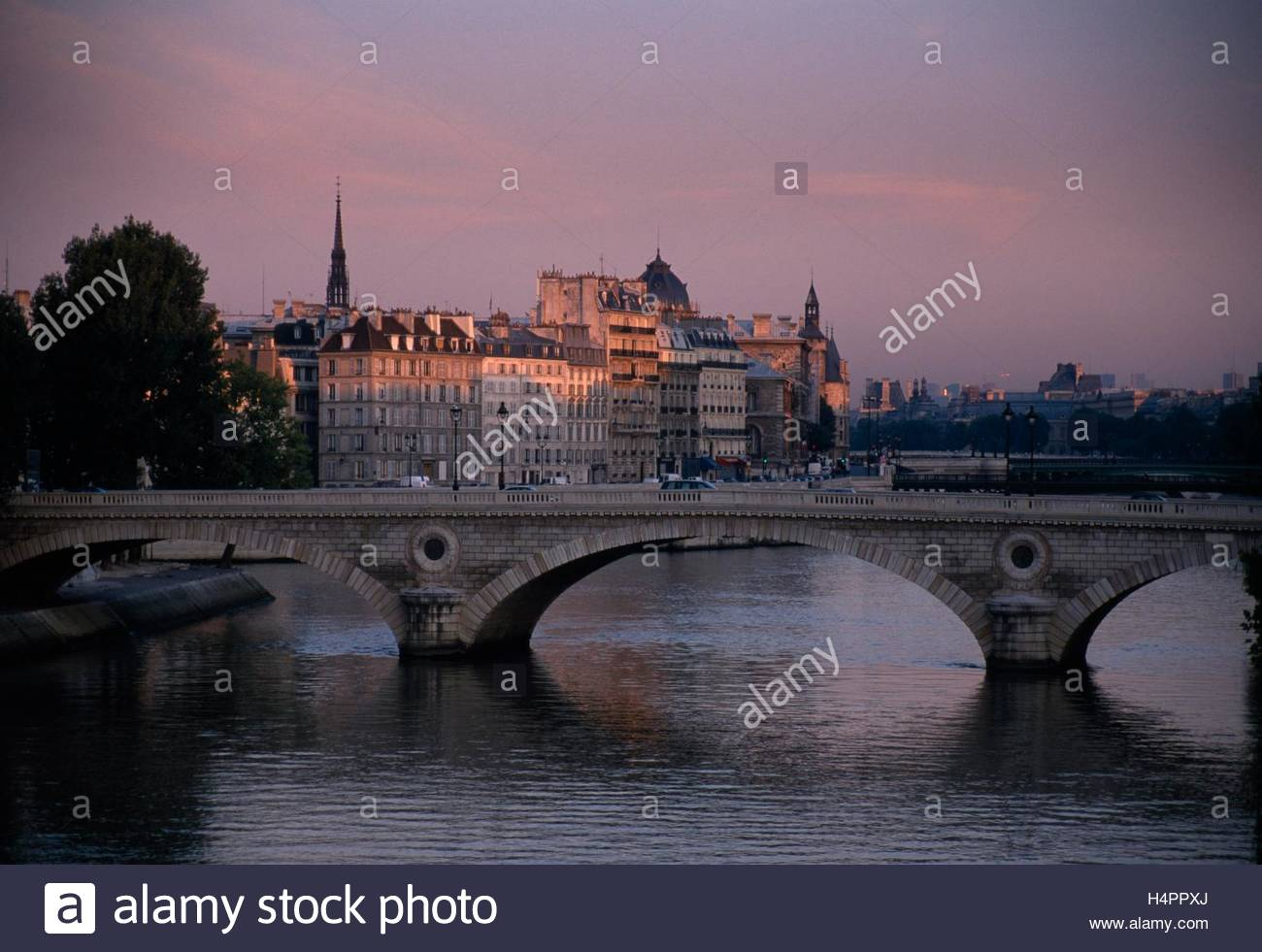 An evening view of the Seine and Ile St. Louis from Pont Marie. - Stock Image