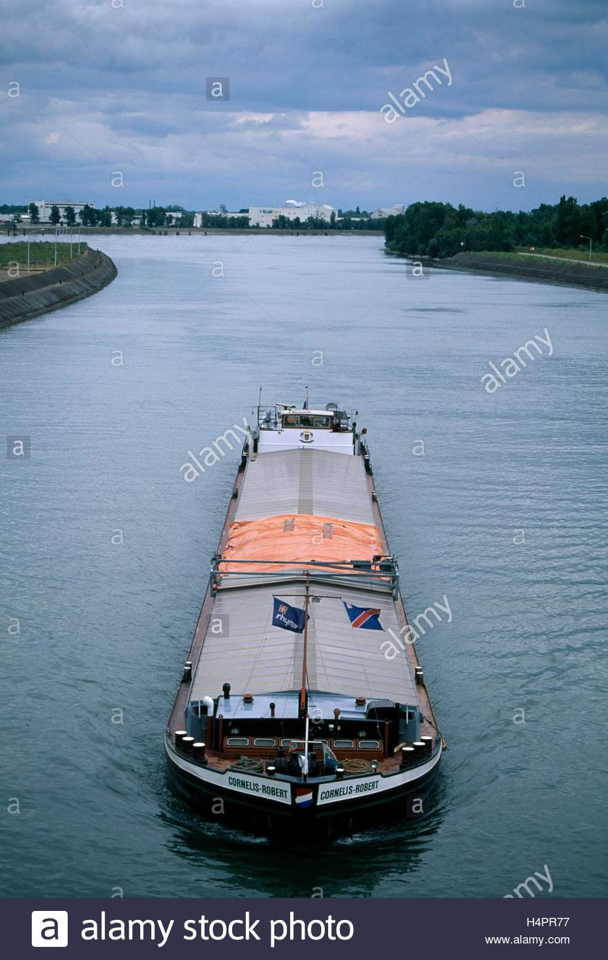 A barge on the Rhine River at Marckolsheim. - Stock Image