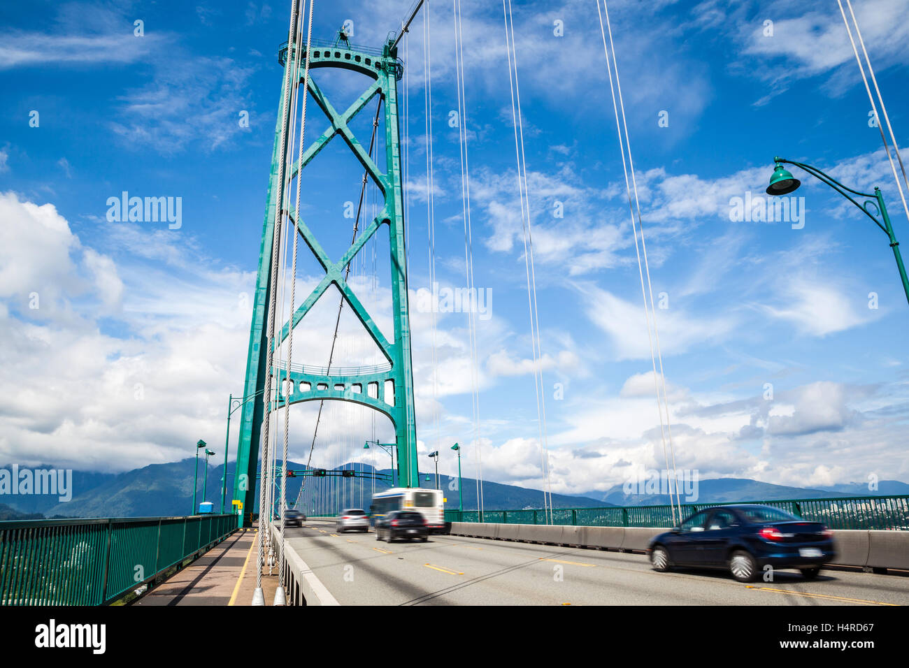 Opened in the 1938, Vancouver's Lions Gate Bridge spans the Burrard Inlet and connects the city to the Northshore - Stock Image