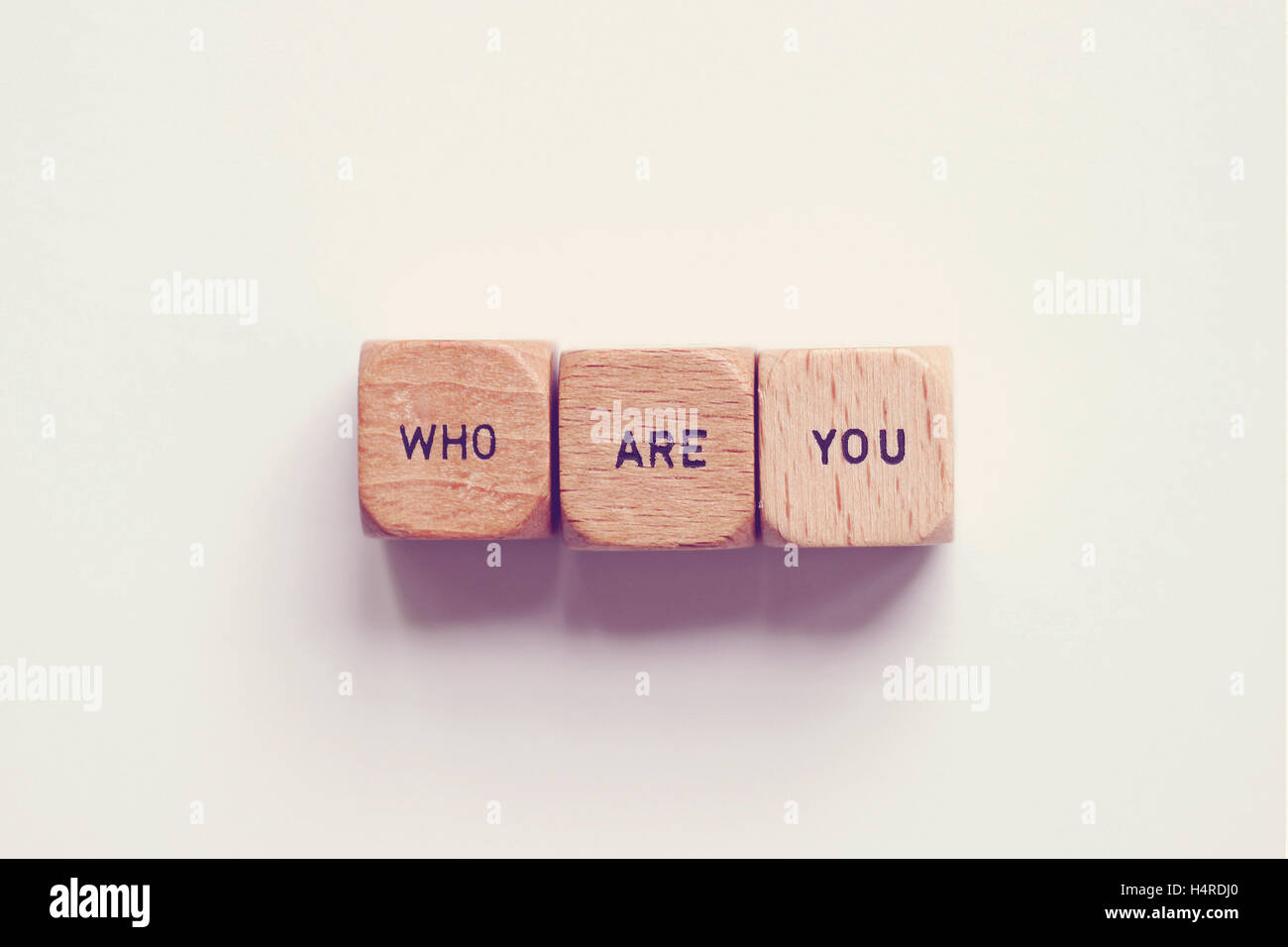 'who are you?' printed on dice - Stock Image