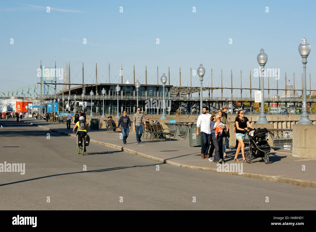 People on the Promenade des Artistes with Jacques Cartier Pavilion in back, Old Port of Montreal, Quebec, Canada - Stock Image