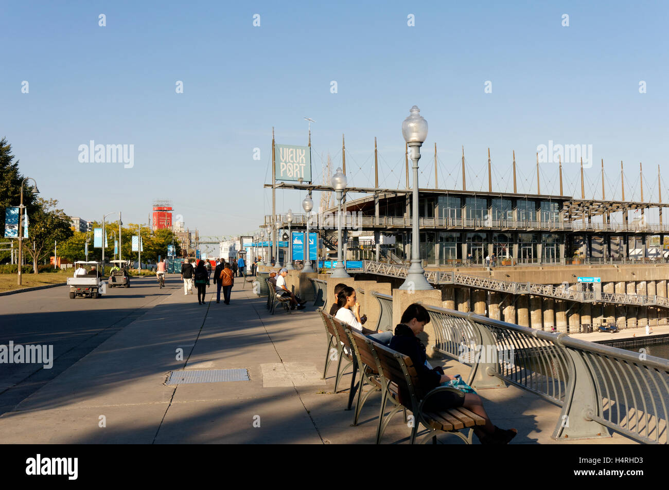 People on the Promenade des Artistes with Jacques Cartier Pavilion in back, Old Port of Montreal, Quebec, Canada Stock Photo