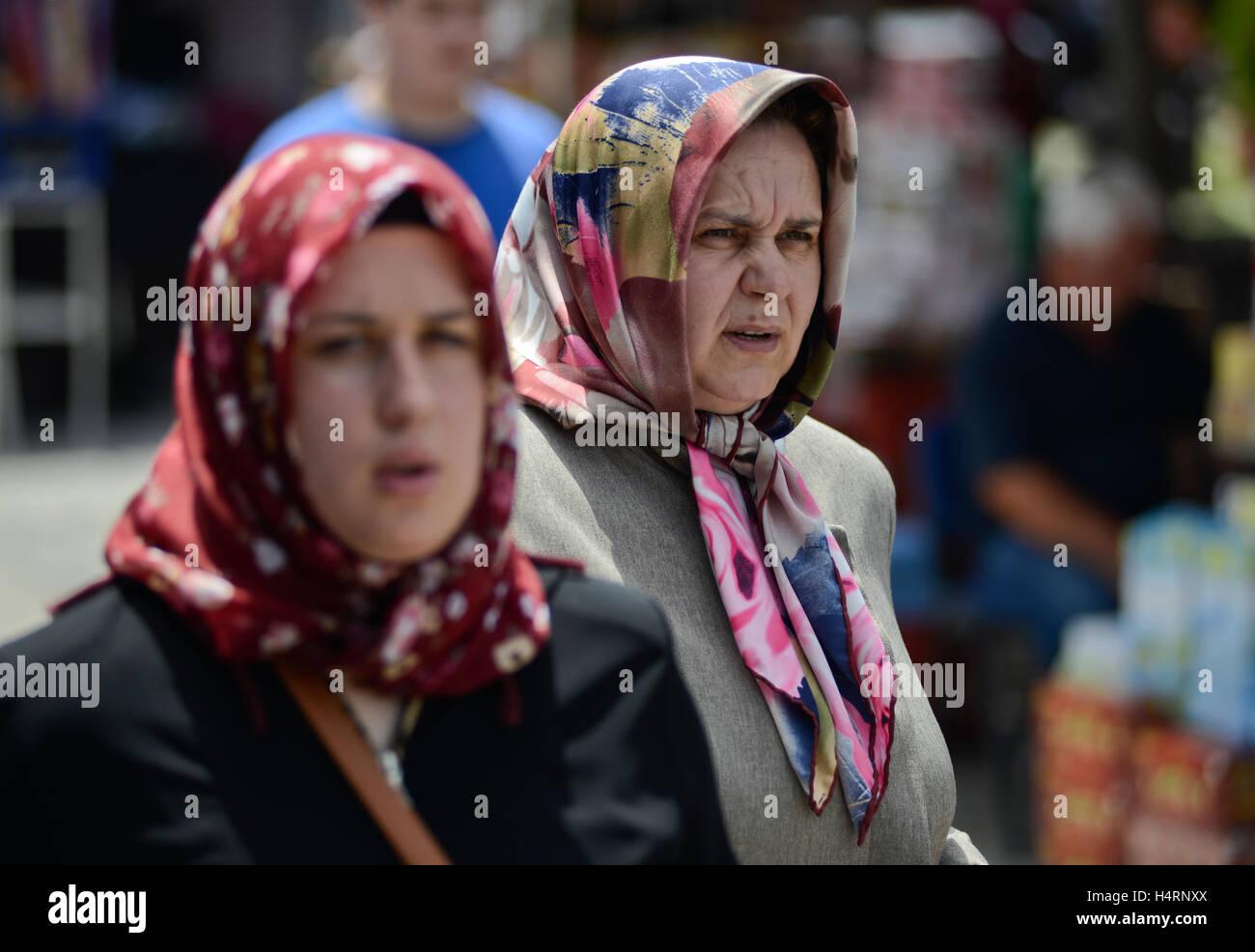 Muslim women walking  across the Old Bazaar. Skopje, Macedonia - Stock Image