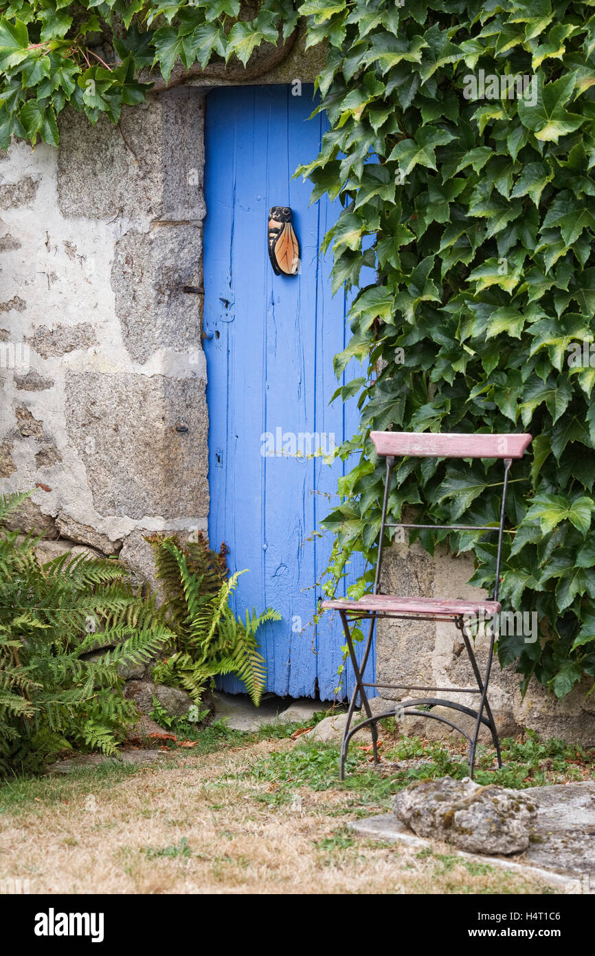 Doorway to a French country cottage. - Stock Image