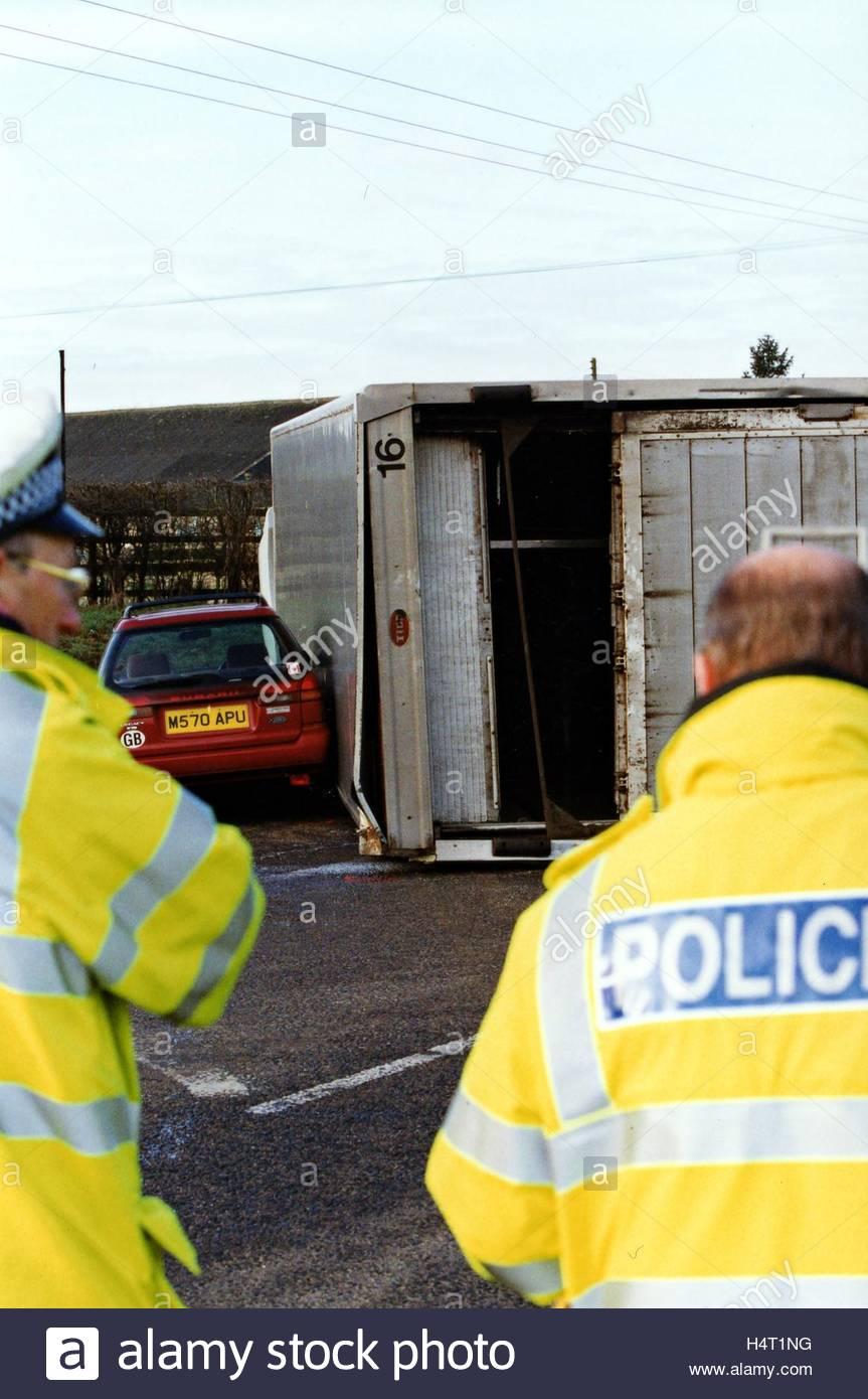 Car driver Dies as Truck topplesStock Photo