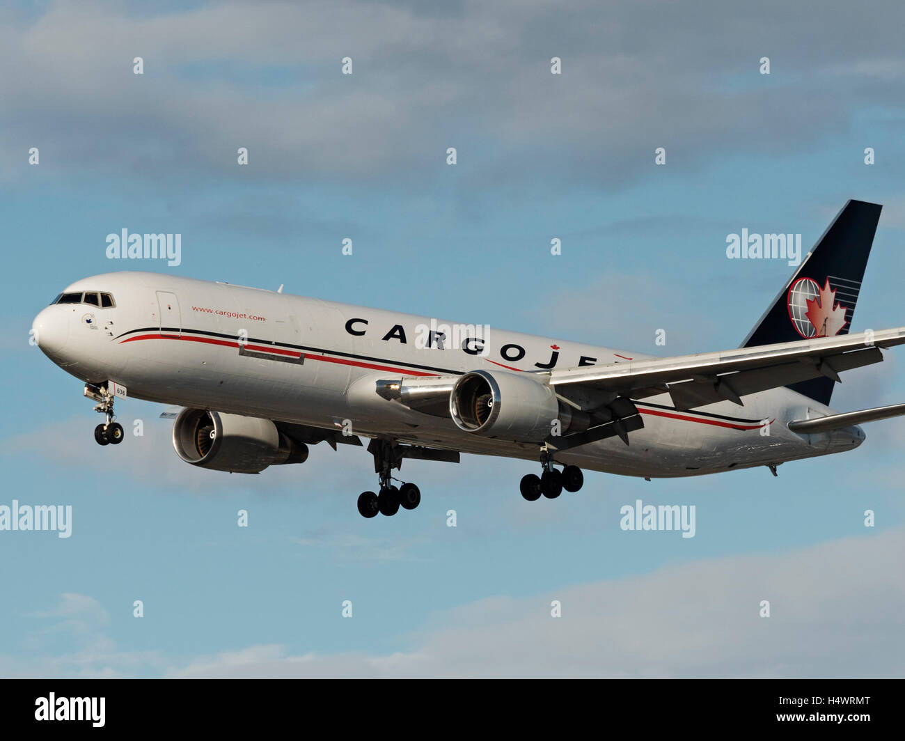 Cargojet Airways Boeing 767 C-FMIJ air cargo freighter final approach for landing Vancouver International Airport, - Stock Image